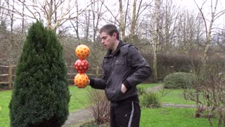 Juggler Shows off Balance Skills with 3 Ball Stack