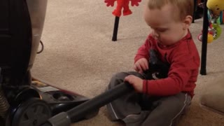 Adorable Baby Entertained By Vacuum Cleaner - Video
