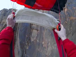 Base Jumper Survives Terrifying Cliff Strike - Video