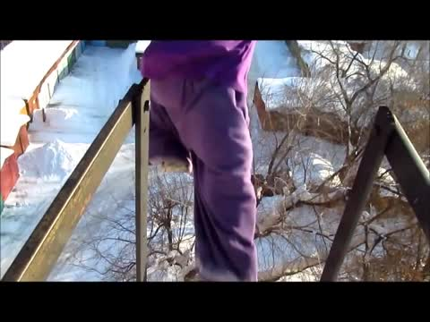 Crazy Russian jumps off building into the snow