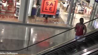 Grabbing People's Hands On An Escalator - Video