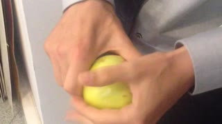 Breaking an apple in half with bare hands - Video