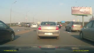 WHITE CAR MALFUNCTIONS ON HIGHWAY - Video