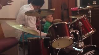 Talented baby drummer keeps a steady beat! - Video