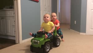 Baby shows off strength, takes brother for a ride! - Video