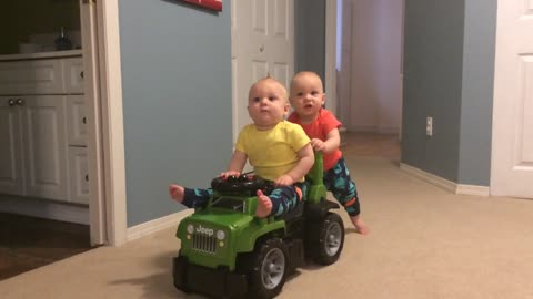 Baby shows off strength, takes brother for a ride!