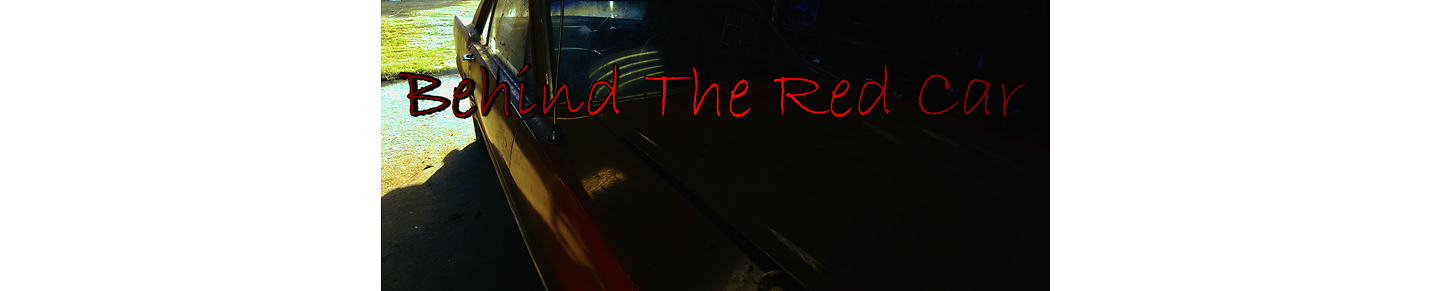 Behind The Red Car